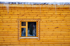 Cottage pine balk wall. Country cottage house pine balk wall with window and icicle Stock Images