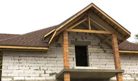 Cottage in the process of construction Wooden arch roof. Roof under construction. Cottage in the process of construction Wooden arch roof Roof under construction Royalty Free Stock Photos