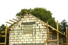 Cottage in the process of construction Wooden arch roof. Roof under construction. Cottage in the process of construction Wooden arch roof Roof under construction Royalty Free Stock Images