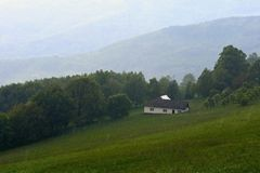 Cottage in the rain. Mountains in the summer on a rainy day. White Carpathians Czech Republic. Royalty Free Stock Photo