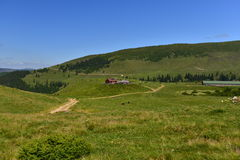 Cottage and ranch in the Rodnei mountains on plateau Royalty Free Stock Image