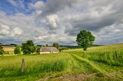 Cottage in a remote area. Czech border landscape with a lonely cottage Royalty Free Stock Images