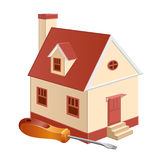 Cottage repair. A house model with screwdriver Stock Image