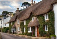Cottage ricoperti di paglia Immagine Stock
