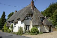 Cottage ricoperto di paglia a Wherwell hampshire l'inghilterra Immagine Stock Libera da Diritti