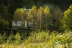 Cottage on river bank Royalty Free Stock Photos