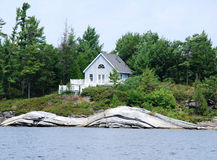 Cottage on rocks Royalty Free Stock Photography