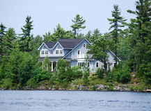 Cottage on rocks Royalty Free Stock Image