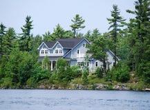 Cottage on rocks Royalty Free Stock Image
