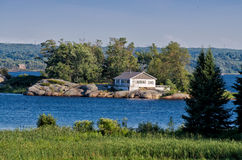 Cottage on a rocky island Royalty Free Stock Images