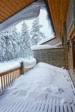 Cottage roof is full of snow and icicle in Ruka in Finland in th Royalty Free Stock Photos