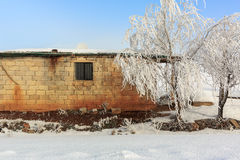 Cottage in a rural area. Covered with snow Stock Images