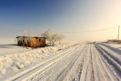Cottage in a rural area. Covered with snow Stock Photo