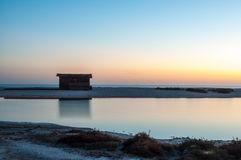 Cottage by the sea at dawn. Cottage by the sea at a dawn blue, pink and orange Stock Image