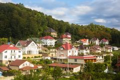 Cottage settlement on slope of low mountain Stock Photography