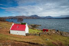 Cottage on the shore of Loch Shieldaig in Scotland Stock Images
