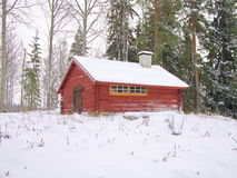 Cottage. Small red cottage in winter landscape Stock Photos