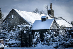 Cottage in snow Stock Photos