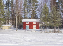 Cottage in snow. LULEÅ,SWEDEN-FEBUARY 21, 2017 :[Red cottage with frosty windows in a snowy landscape Stock Photos