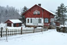 Cottage during snow storm Royalty Free Stock Images