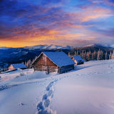 Cottage in snowy mountains with fabulous winter trees Stock Images