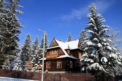 Cottage in snowy winter season Royalty Free Stock Images