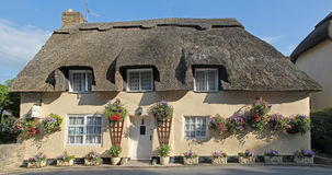 Cottage with straw thatched roof, bed and breakfast house Stock Photos