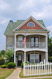Cottage Style House. A New Cottage Style House with White Fence Royalty Free Stock Image