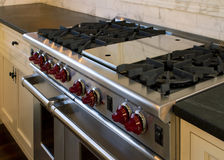 Cottage style kitchen gas cooking range. New modern cottage style home with natural gas cooking range Royalty Free Stock Photo