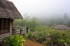 Cottage style resort in foggy morning Stock Photos
