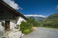 Cottage in Swiss Alps stock photos