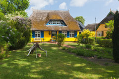 Cottage with thatched roof Stock Photos