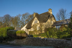 Cottage with thatched roof in historic Castle Combe from the street Royalty Free Stock Photo