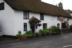 Cottage tradizionale nella traversa di Wheddon Fotografia Stock