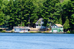 Cottage and two boathouses Stock Photo