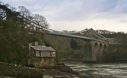 A Cottage Under the Menai Suspension Bridge Royalty Free Stock Photos