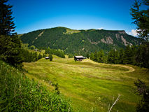 Cottage in valley, Alpe di Siusi, Italy Stock Photos