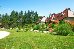 Cottage village. Weekend mountain houses green grass in Serbia, Zlatibor Royalty Free Stock Photography