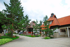 Cottage village. Weekend houses with gardens and stone road in Serbia, Zlatibor Royalty Free Stock Photo