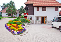 Cottage village. Weekend houses with gardens and stone road in Serbia, Zlatibor Royalty Free Stock Photos