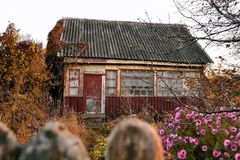 Cottage in the village in the fall stock photos