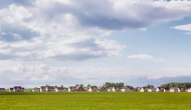 Cottage village field and sky Stock Photography