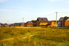 Cottage village near the meadow. In the autumn day. Luxury country real estate Stock Photography