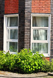 Cottage wall with windows Stock Photography
