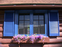 Cottage Window. Blue Window Shutters At A Log Construction Cottage Royalty Free Stock Photography