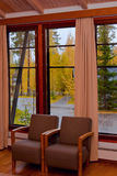 Cottage window autumn view. Fall view through the countryhouse window Royalty Free Stock Image