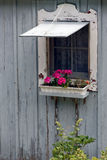 Cottage Window with Flower Box. An old cottage wall with open window and flower box Royalty Free Stock Photos