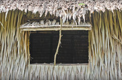 Cottage window made of coconut leaves. Royalty Free Stock Images