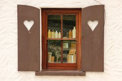 Cottage window shutters decorated with hearts. Ireland Royalty Free Stock Images
