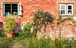Cottage windows. An old cottage in the sun royalty free stock images
